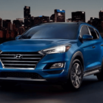 2020 Hyunda Tucson parked near city skyline