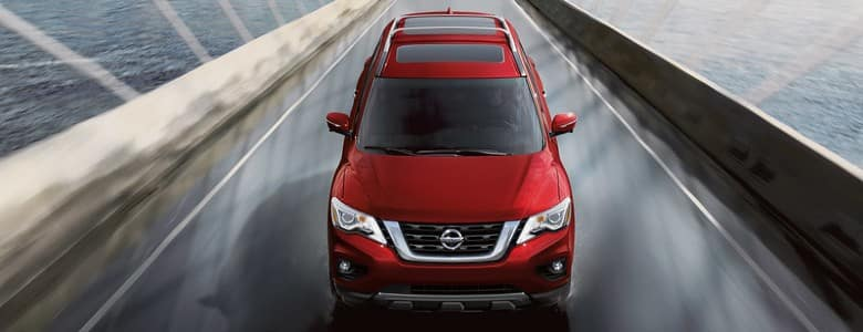 A red 2020 Nissan Pathfinder - Bert Ogden Nissan in McAllen, TX