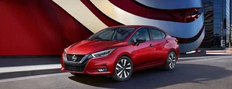 A red 2020 Nissan Versa - Bert Ogden Nissan in McAllen, TX