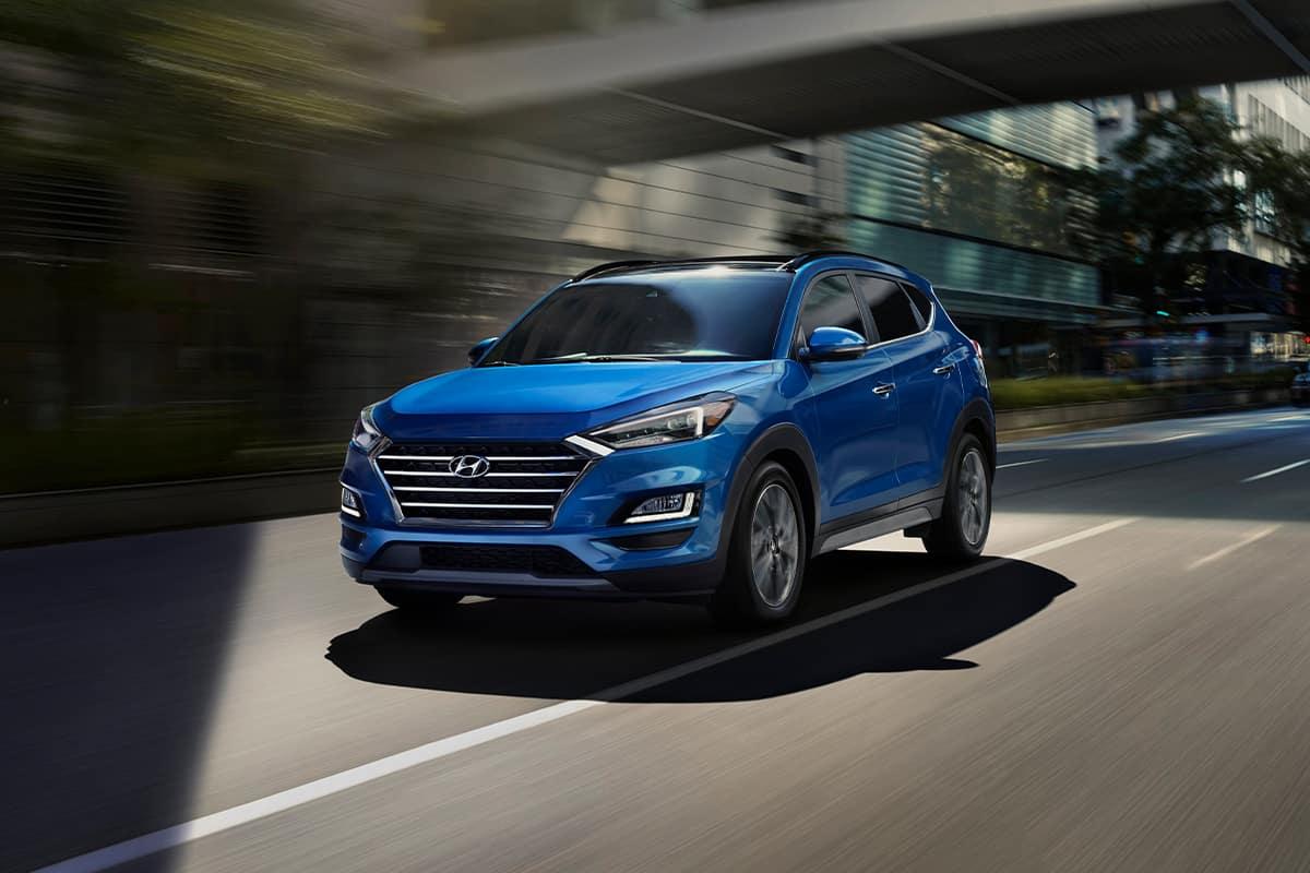 Boch Hyundai is a Hyundai Dealer Near Canton MA | Bright Blue 2020 Tucson Driving Through City