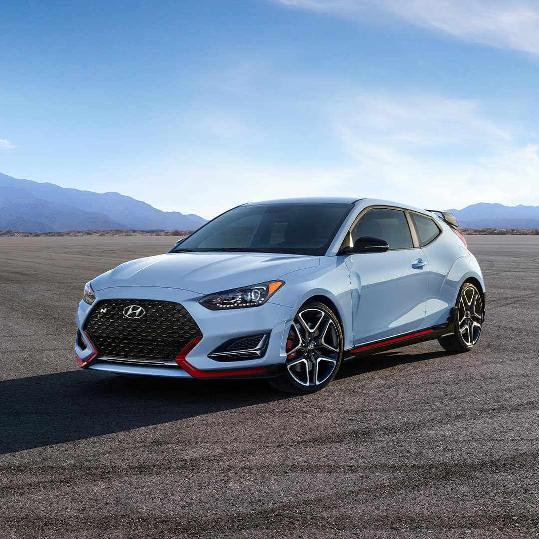 Boch Hyundai is a Hyundai Dealer Near Canton MA | Light Blue 2020 Veloster Parked with Mountains in Background