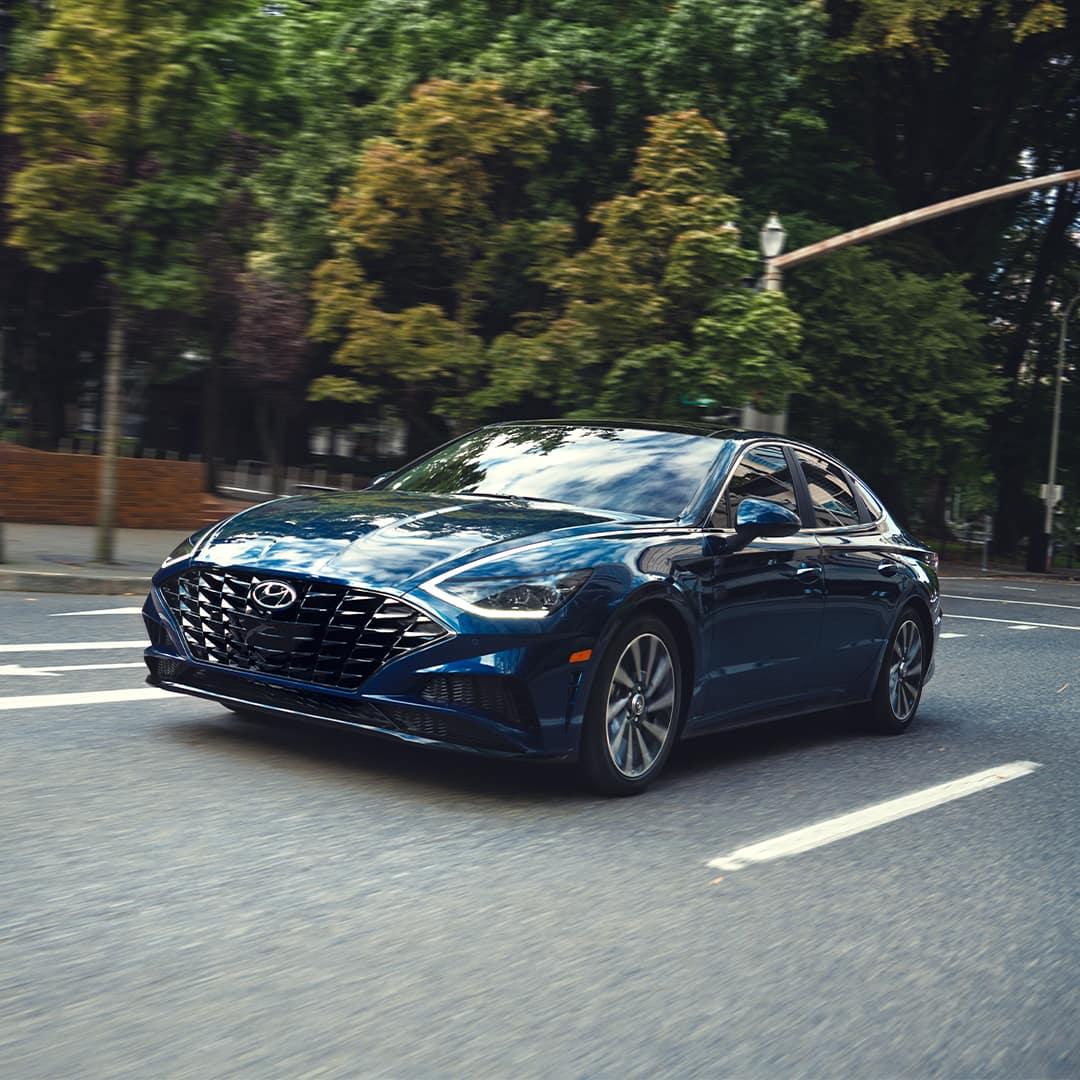 Boch Hyundai is a Hyundai Dealer Near Canton MA | Blue 2020 Sonata Driving Past Trees