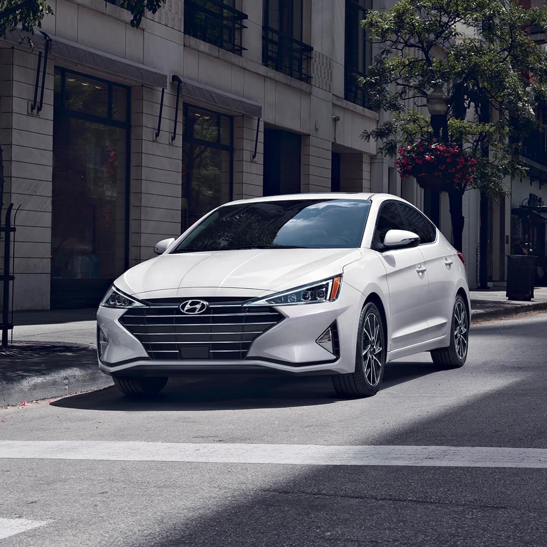 Boch Hyundai is a Hyundai Dealer Near Canton MA | White 2020 Hyundai Elantra Waiting at Crosswalk