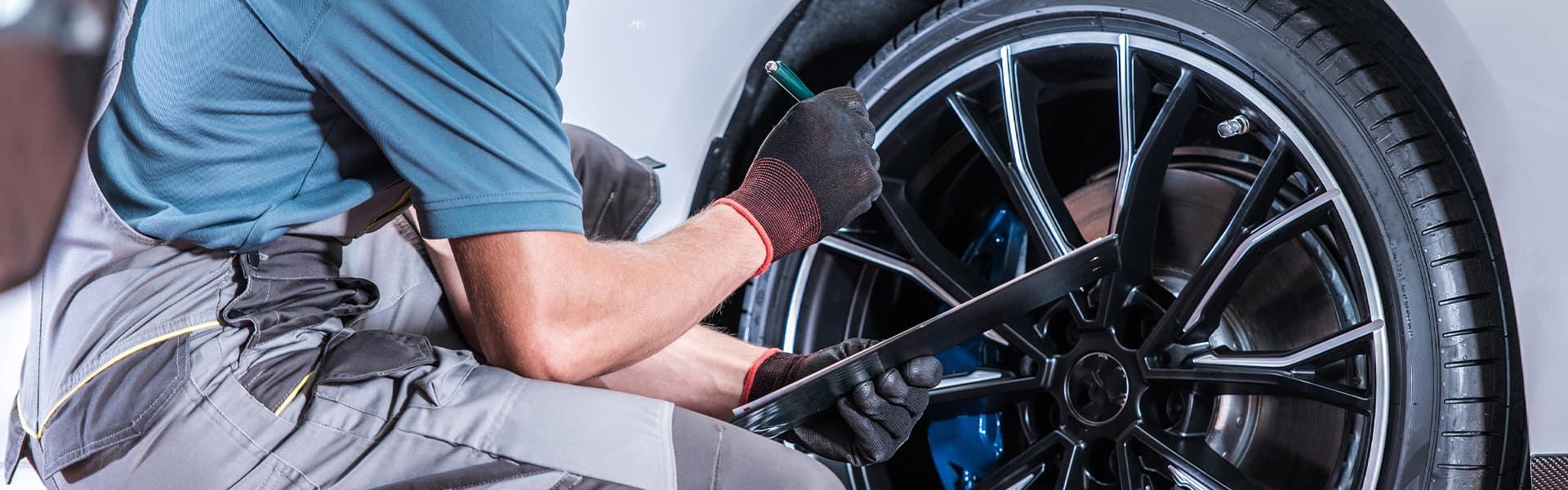 Boch Hyundai is a Hyundai Dealer Near Canton MA | Service Advisor Working on Tire