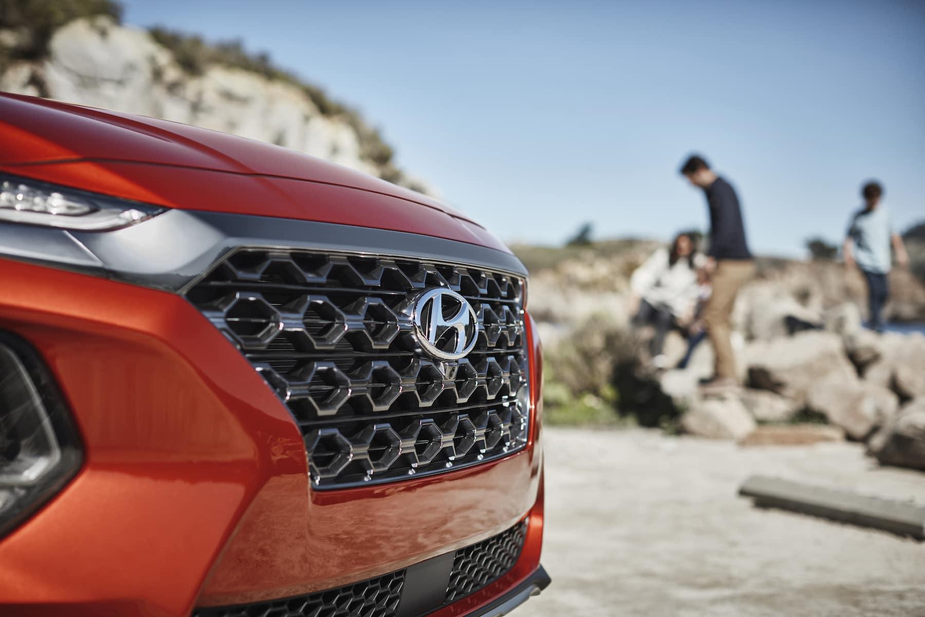 The 2020 Hyundai Santa Fe model features at Boch Hyundai of Norwood MA | Orange SantaFe Close Up Grill