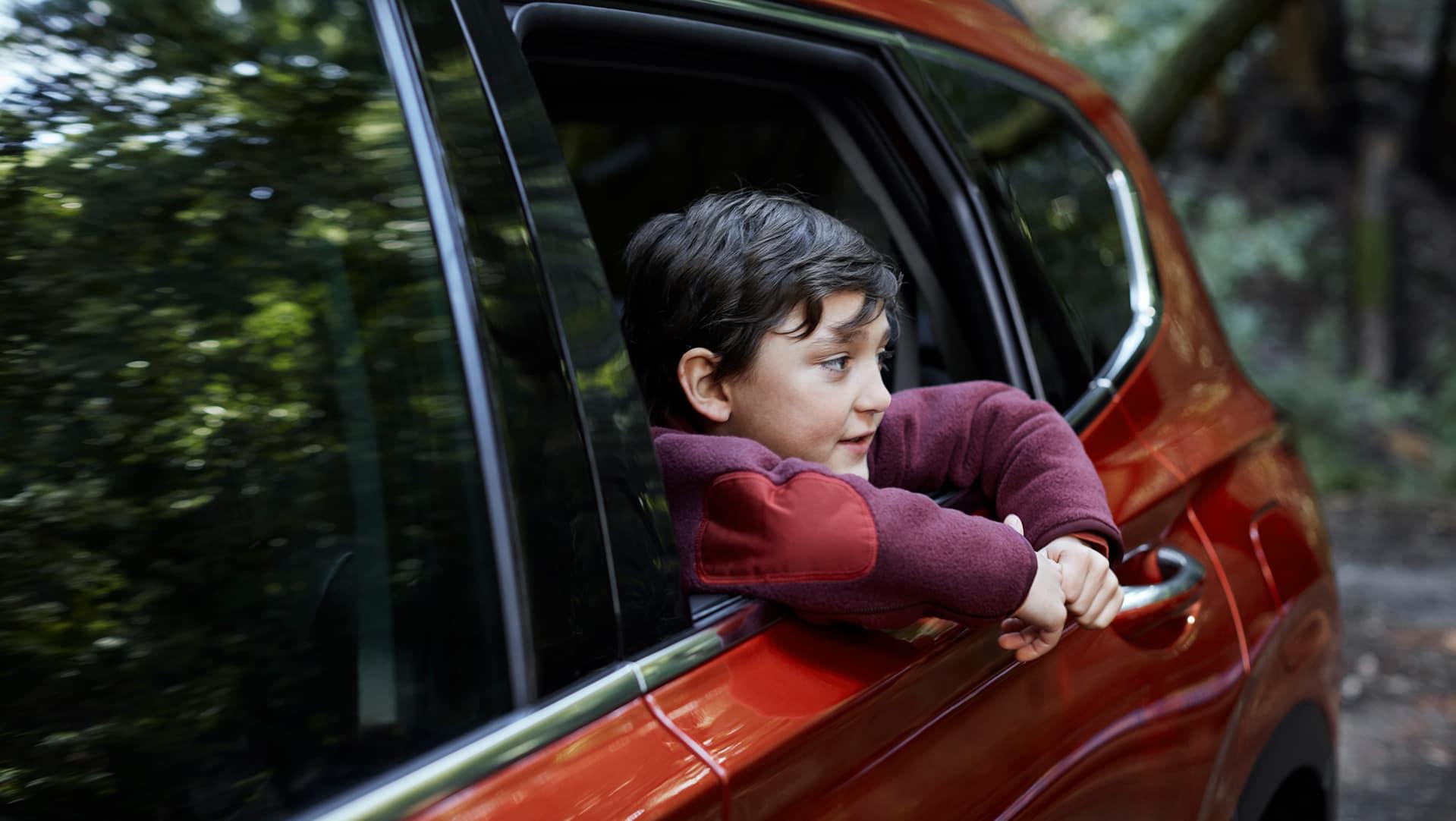 The 2020 Hyundai Santa Fe model features at Boch Hyundai of Norwood MA | Orange MY20 SantaFe Close Up Exterior Kid Window