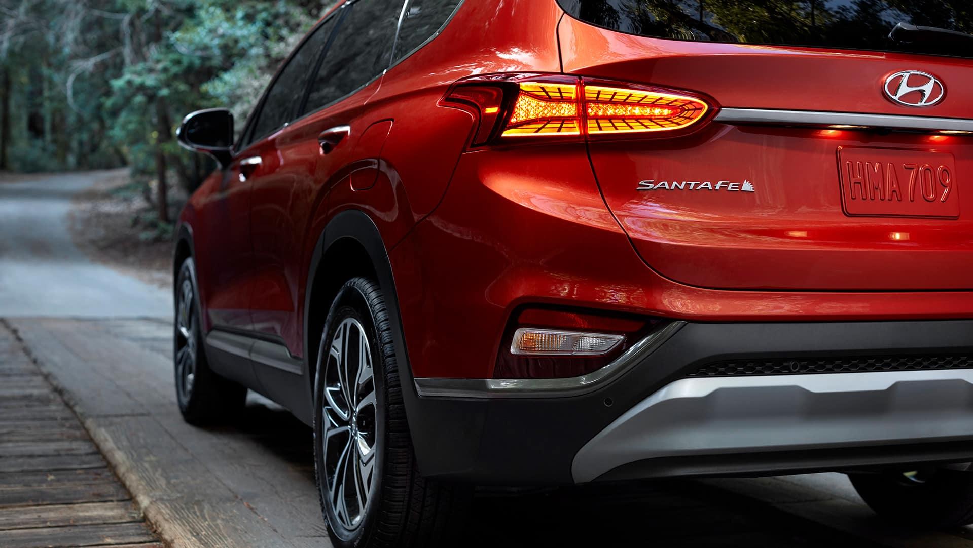 The 2020 Hyundai Santa Fe model features at Boch Hyundai of Norwood MA | Orange MY20 SantaFe Exterior Close Up Rear