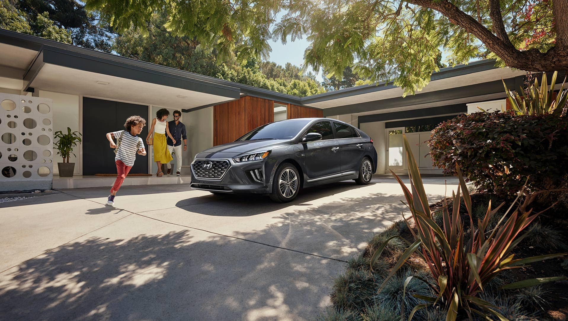 Boch Hyundai is a Luxury Car Dealership near Boston MD | Grey MY20 Hyundai Ioniq parked in driveway with family coming outside of house to get inside