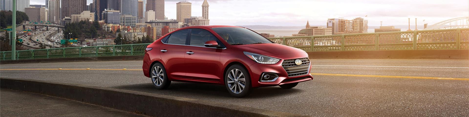 Boch Hyundai is a Car Dealership near Brockton MA | Red MY20 Hyundai Accent driving on highway outside city