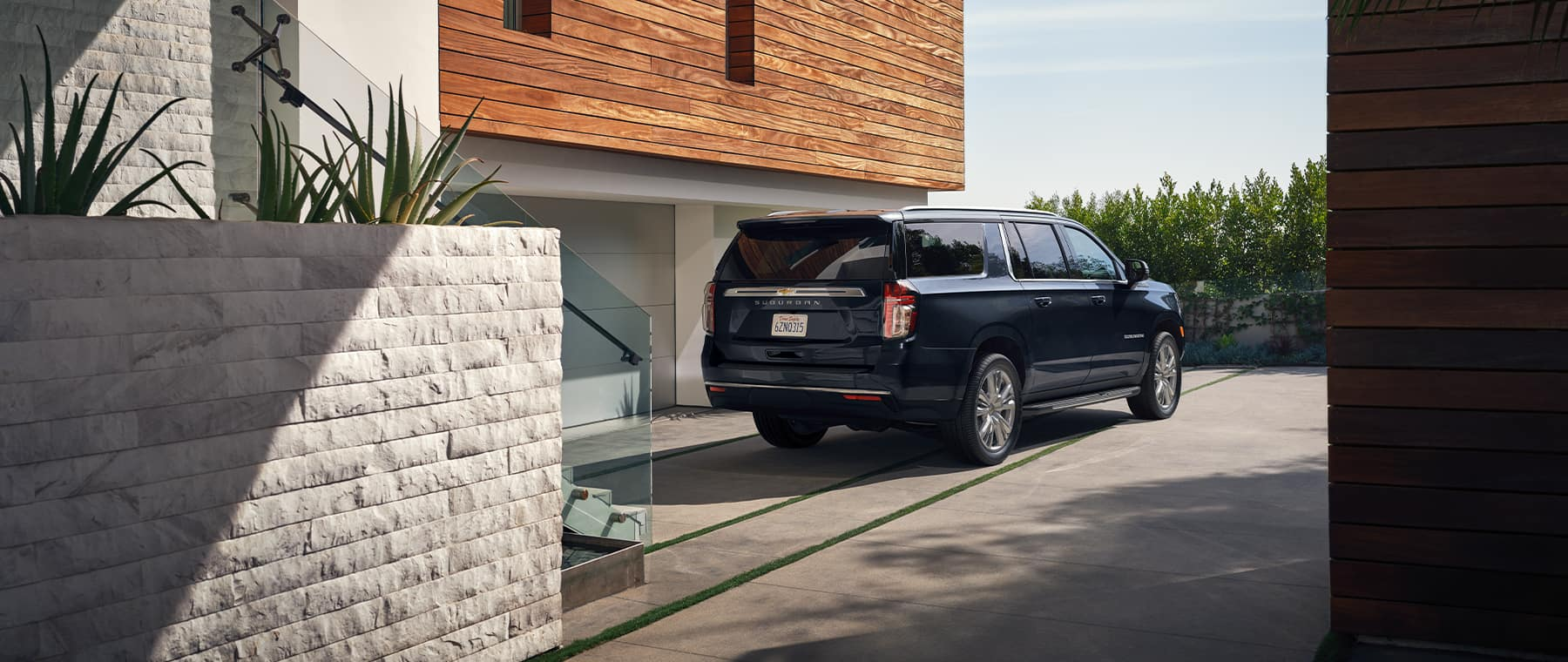 2021 Chevrolet Suburban in front of a luxurious home