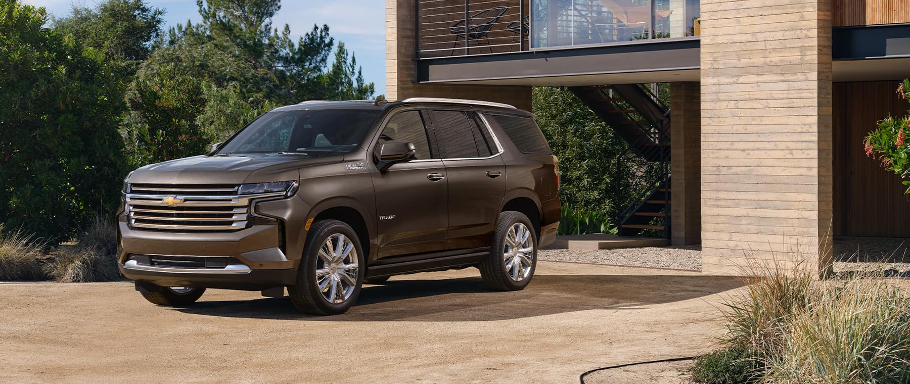 2021 Chevrolet Tahoe in front of a luxurious home