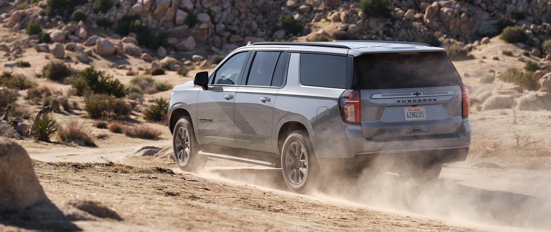 2021 Chevrolet Suburban driving on gravel road