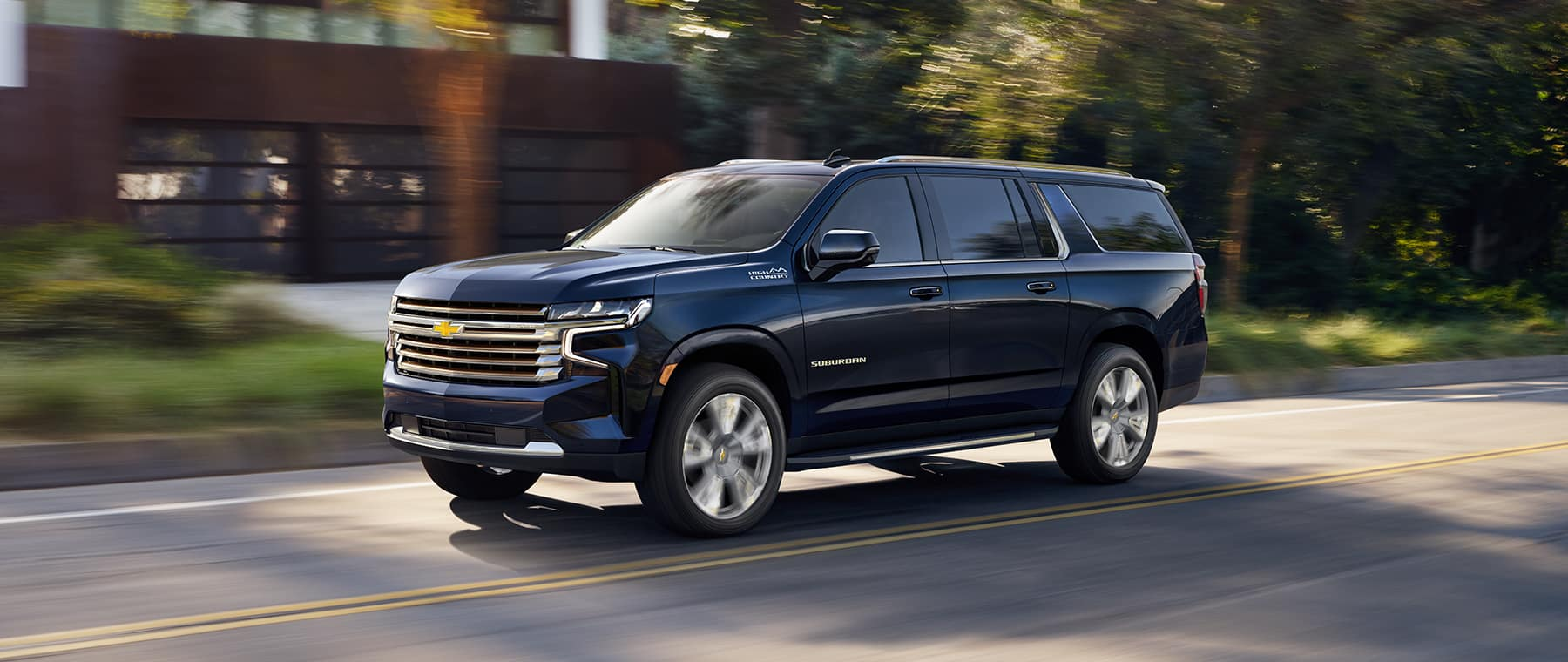 2021 Chevrolet Suburban driving down the avenue