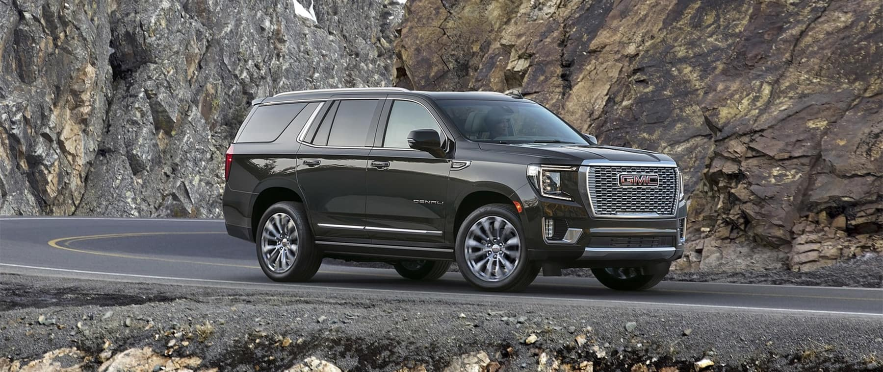2021 GMC Yukon black on side road