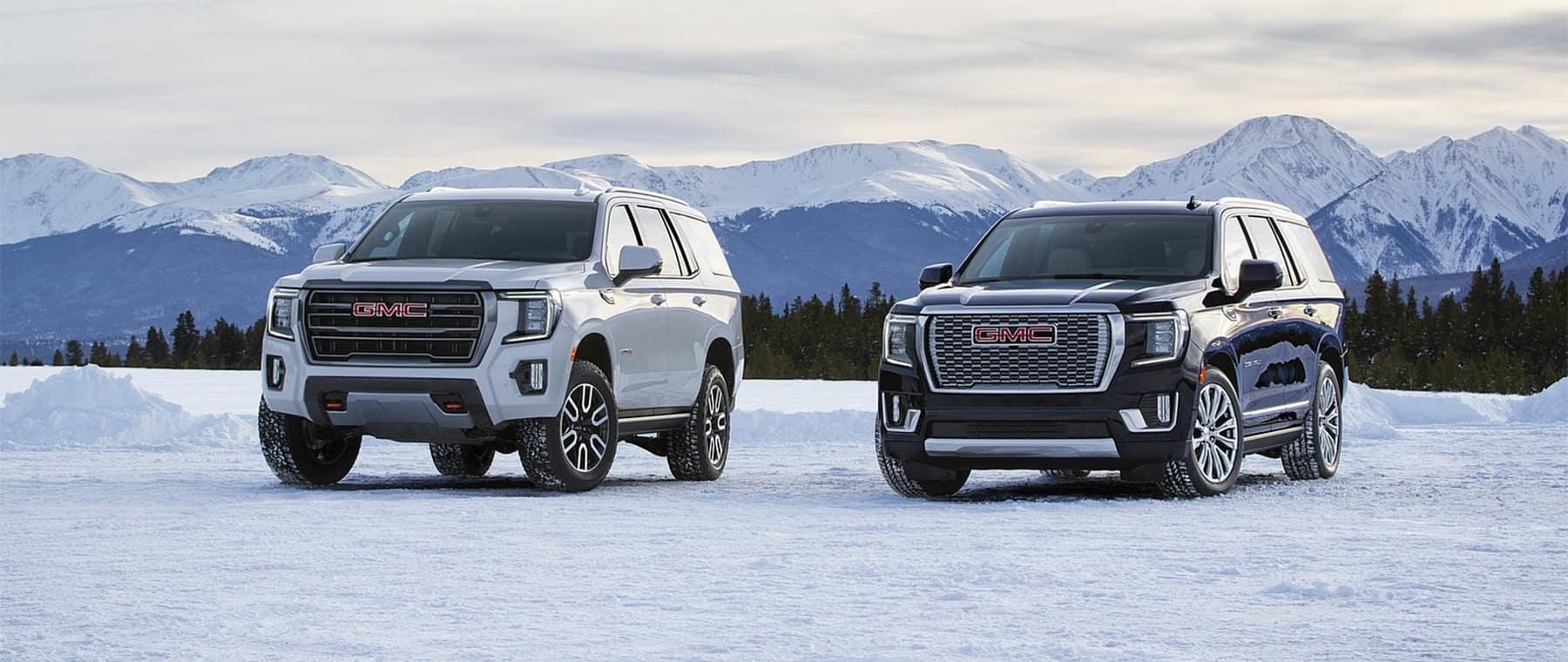 2021 GMC Yukon pair in front of mountain range