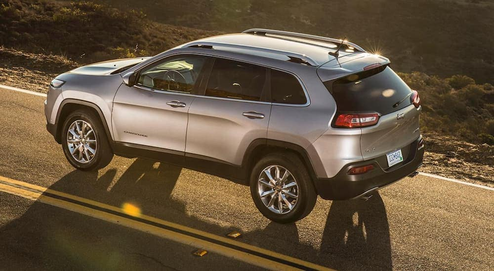 A silver 2018 Jeep Cherokee is shown from above at sunset.
