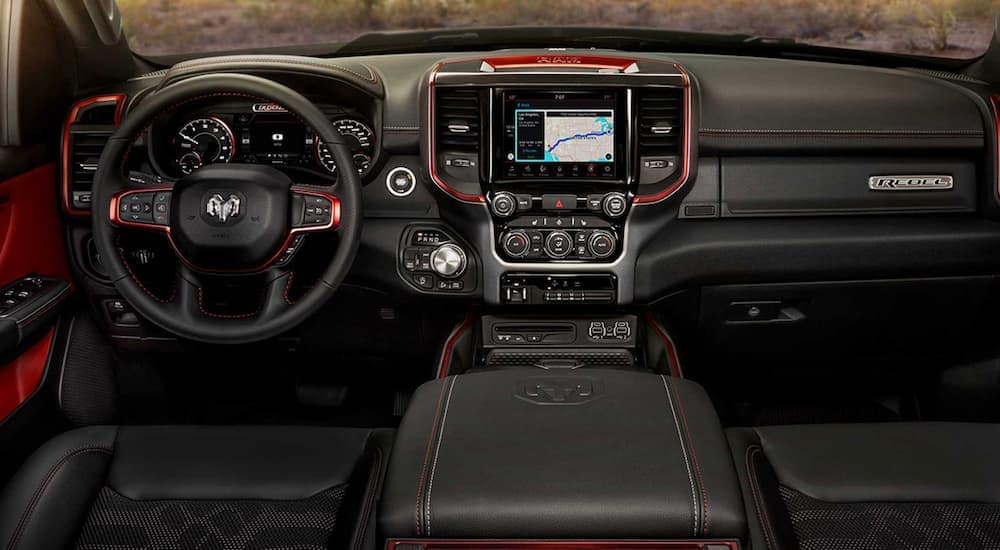 The entertainment features and dashboard are shown on a 2019 Ram 1500 Rebel.