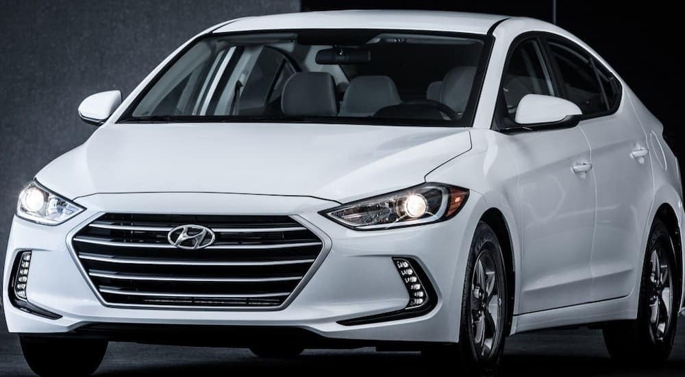 A white 2018 Hyundai Elantra is shown with a grey background.