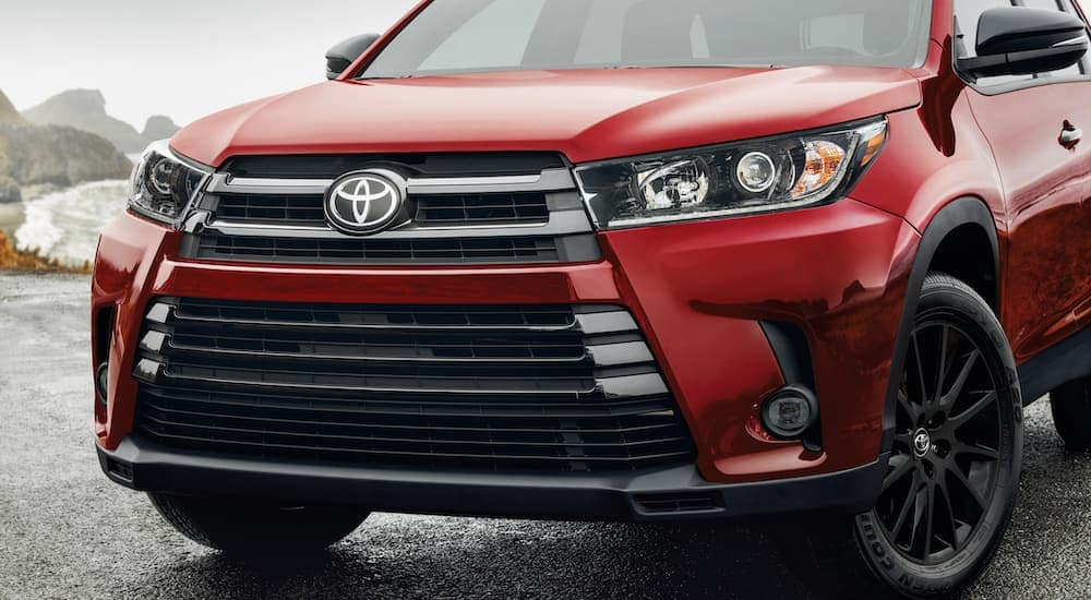 The front end of a red 2019 Toyota Highlander is shown.