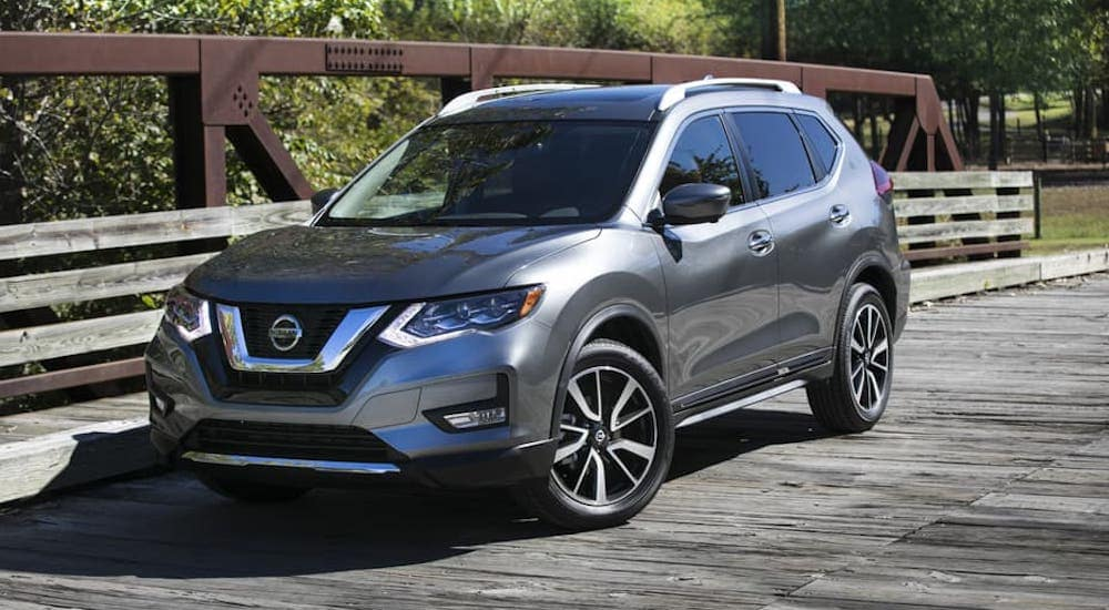 A gray 2018 Nissan Rogue is parked on a bridge near Durham, NC.