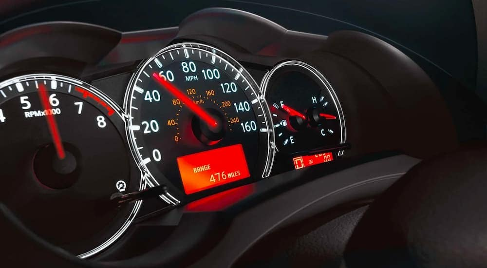The gauge cluster is shown on the 2011 used Nissan Altima.