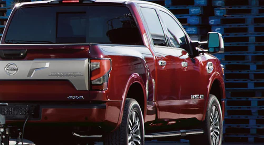 A red 2021 Nissan Titan XD is shown from a side angle.