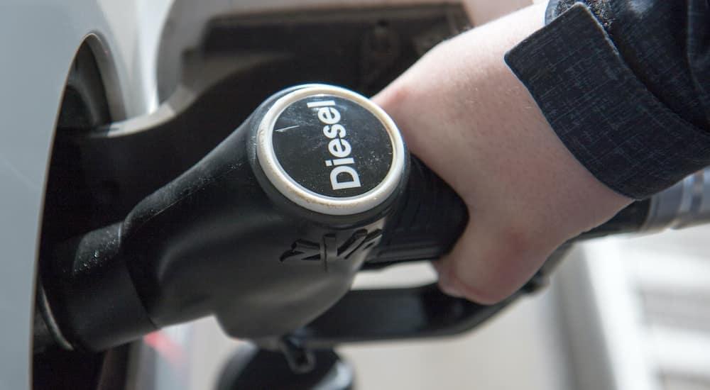 A man is holding a diesel pump.