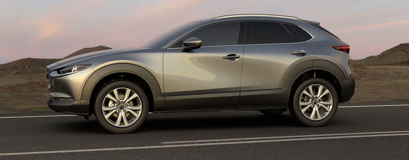 A grey 2020 Mazda CX-30 is parked on a road near Indiana, PA, at sunset.