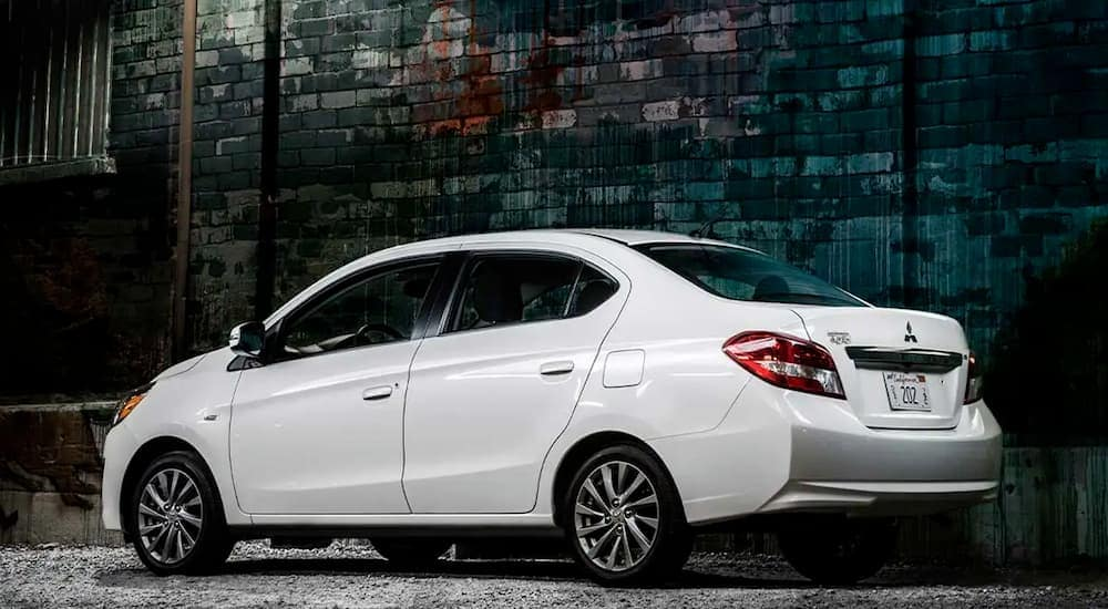 A white 2020 Mitsubishi Mirage G4 is parked in an alley near Indiana, PA, after leaving a Mitsubishi dealer.