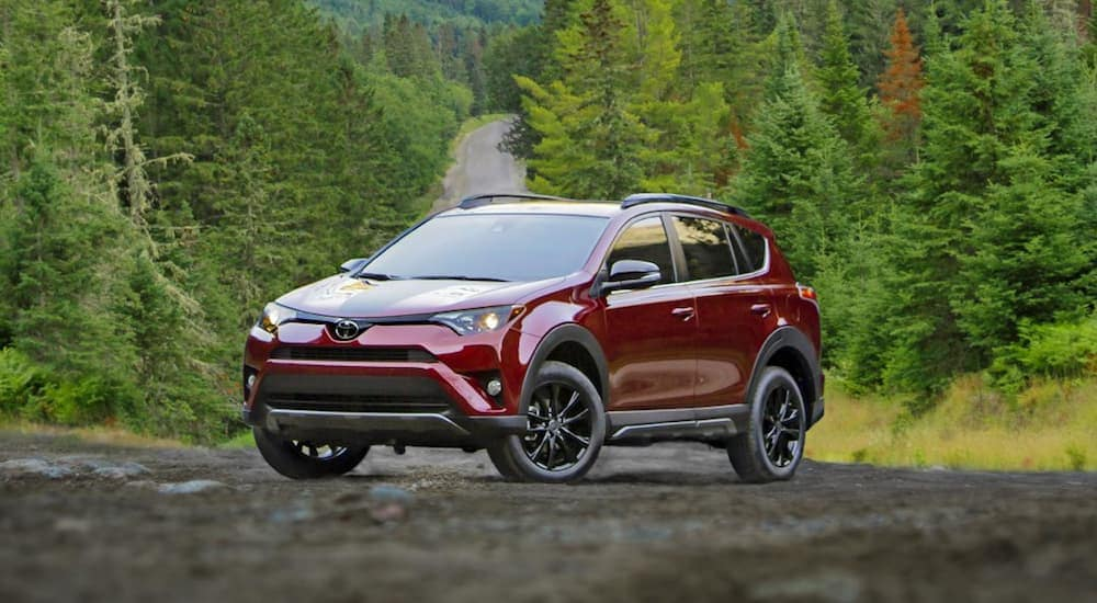 A red 2018 Toyota RAV4 is parked on a tree lined road near Indiana, PA.