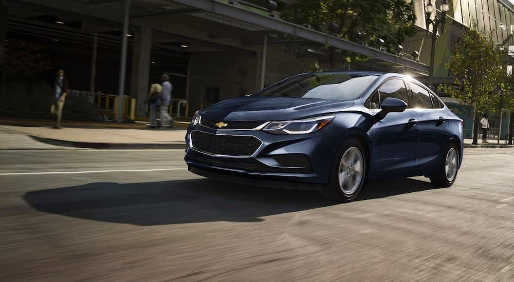 A blue 2017 Chevy Cruze is driving downtown near Indiana, PA.