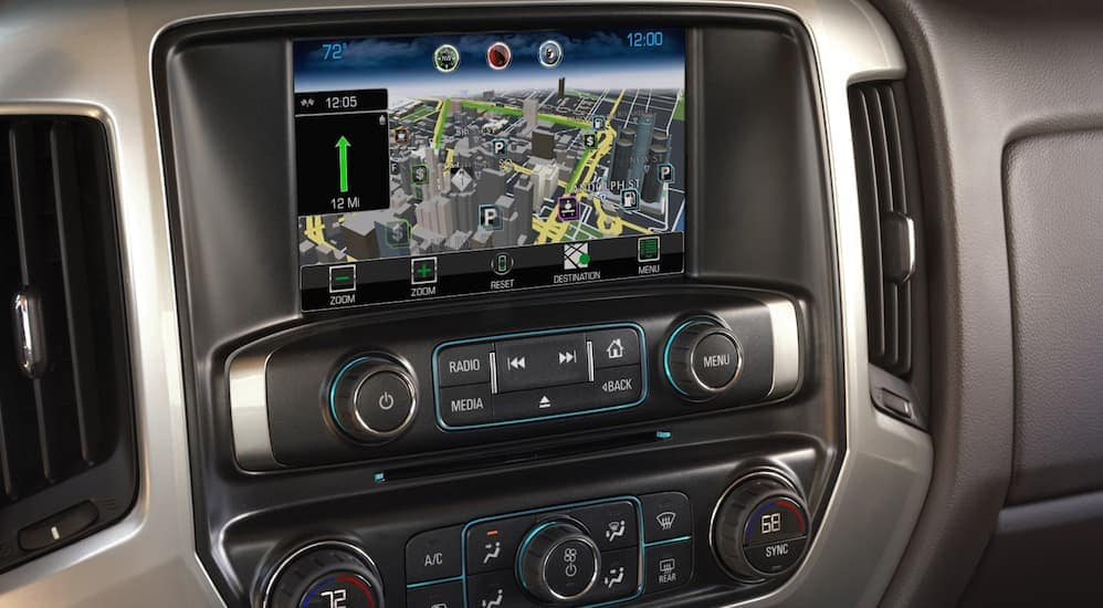 An infotainment system is shown inside of a used Chevy Silverado, which is popular among used cars for sale.