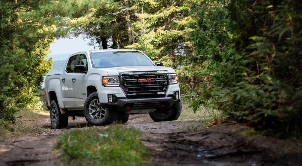 A white 2021 GMC Canyon is on a trail in the woods near Indiana, PA.