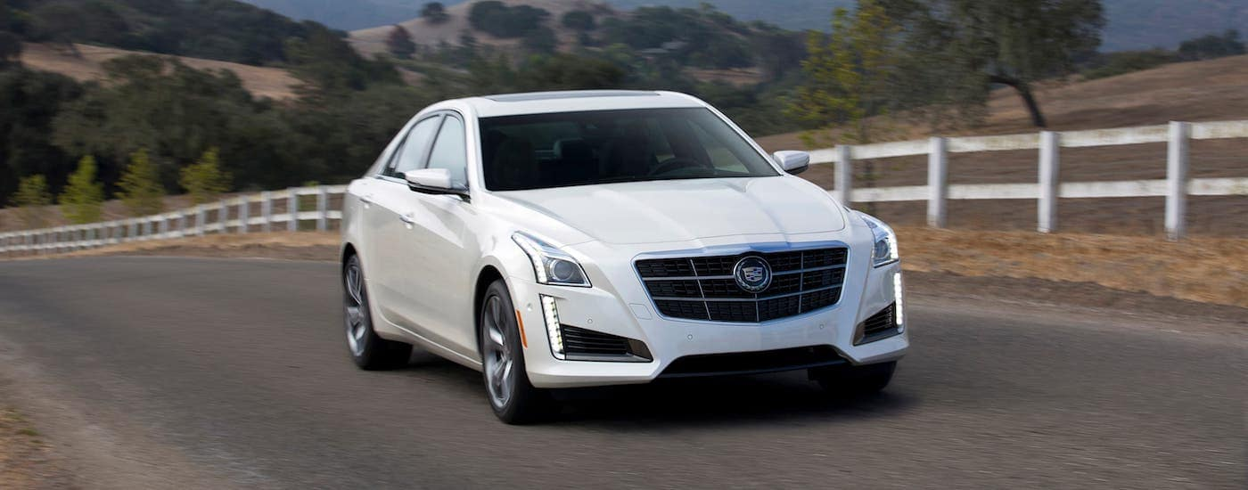 A white 2014 Cadillac CTS-V driving on a country road