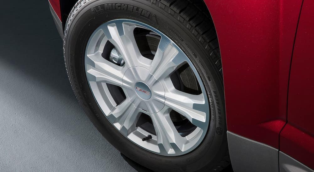 A closeup of the wheel on a red 2017 GMC Terrain, find one at a Used Car Dealership Near Me in Indiana, PA.