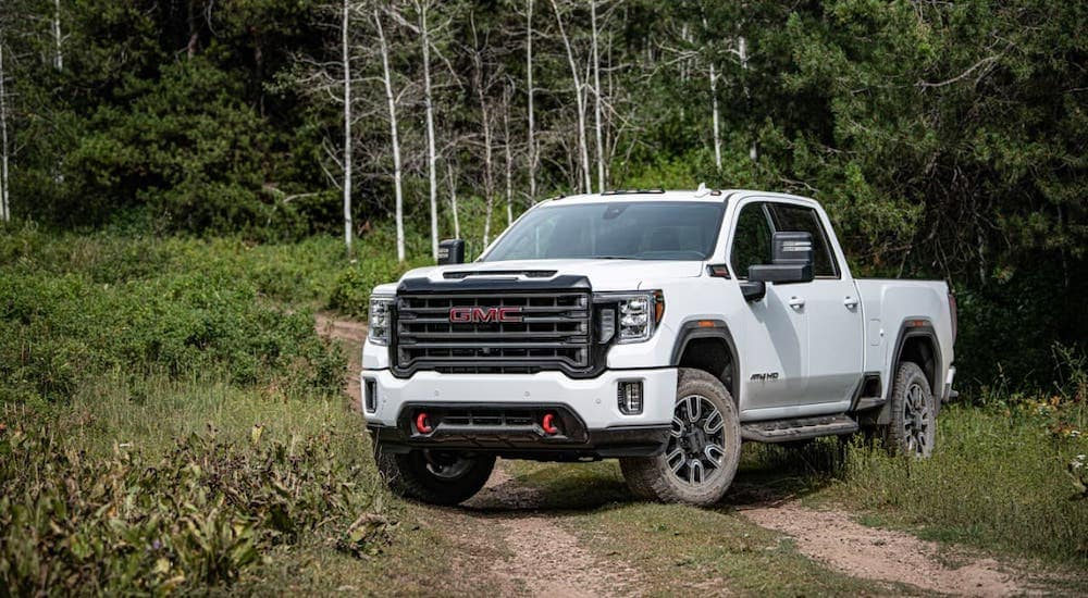 A white 2020 GMC Sierra HD is parked on a dirt trail outside Indiana, PA.