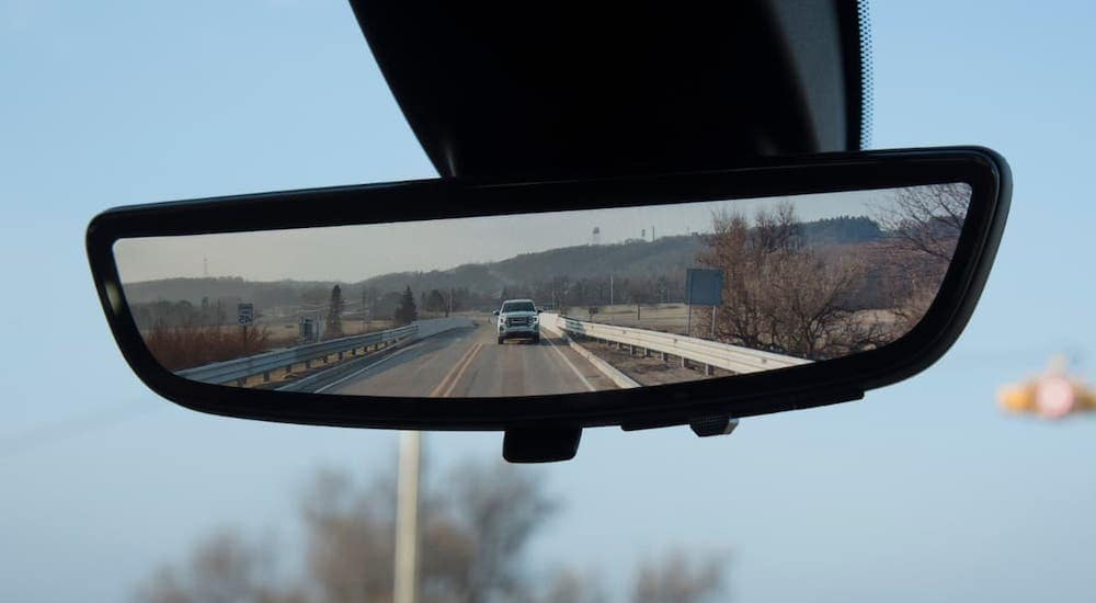 A closeup of the rearview mirror camera in a 2020 GMC Sierra HD, from a GMC dealer near me.
