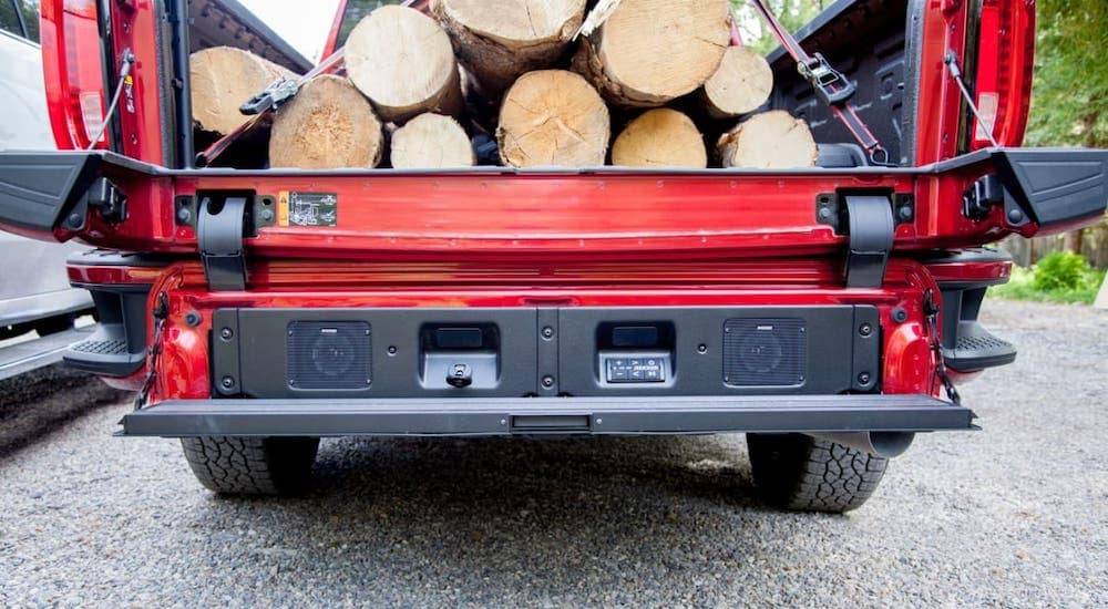 A closeup of the multipro tailgate on a red 2020 GMC Sierra HD outside Indiana, PA, is shown.