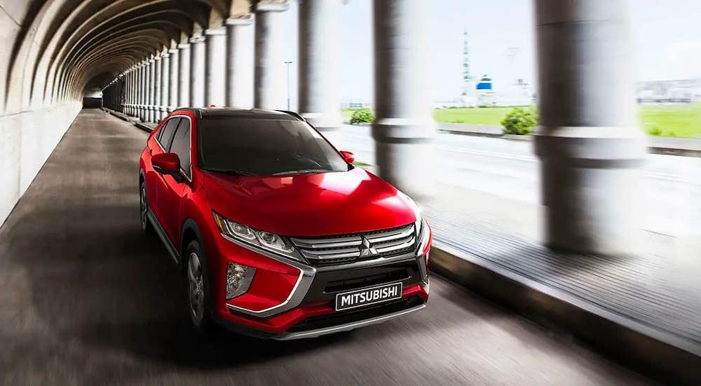 A red 2020 Mitsubishi Eclipse Cross from a local Mitsubishi dealer is driving in a tunnel outside Indiana, PA.