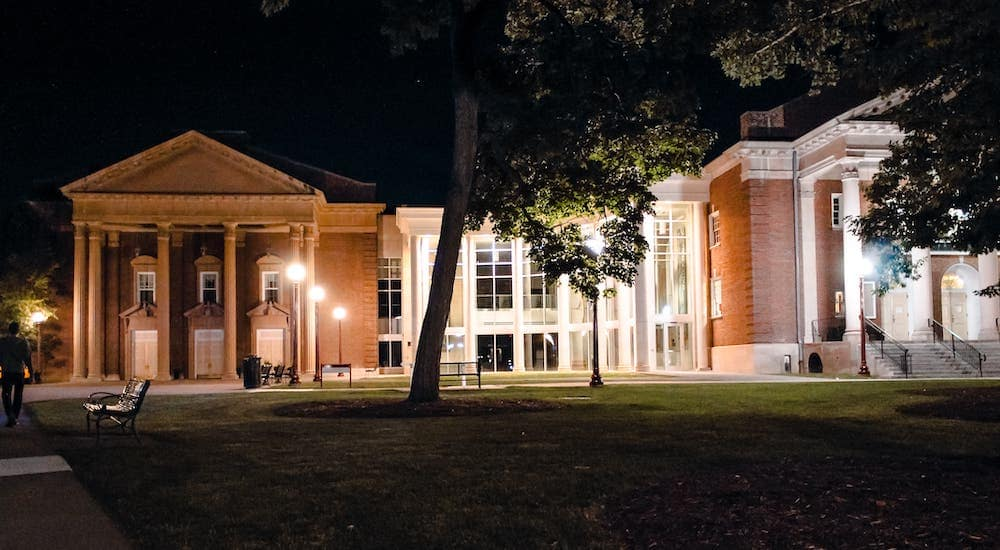 A building from the IUP campus is shown at night.