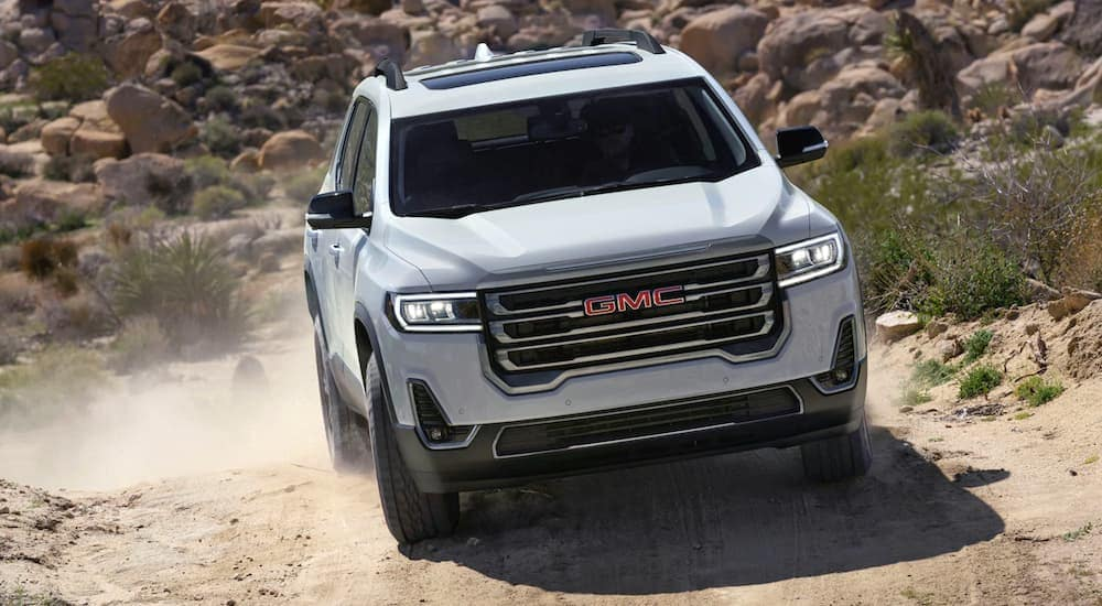 A white 2020 GMC Acadia AT4 is off-roading on a dirt tail near Indiana, PA.