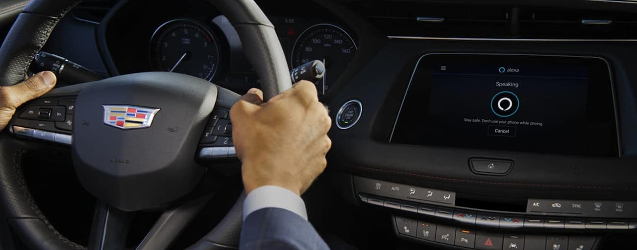 The wheel and infotainment screen in a 2021 Cadillac XT4 are shown.