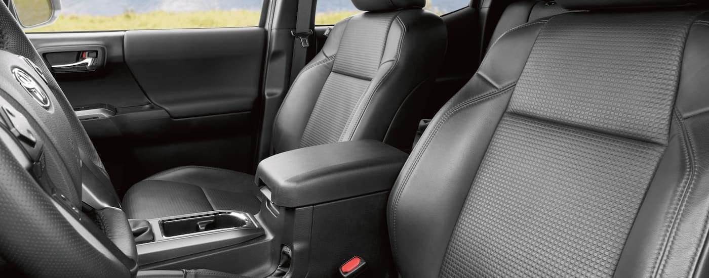 The black interior of a 2021 Toyota Tacoma is shown.