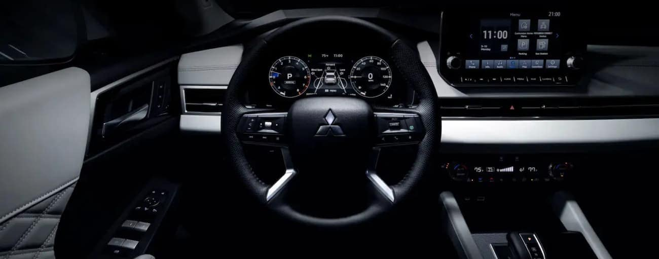 The wheel and screen are shown in a 2022 Mitsubishi Outlander.