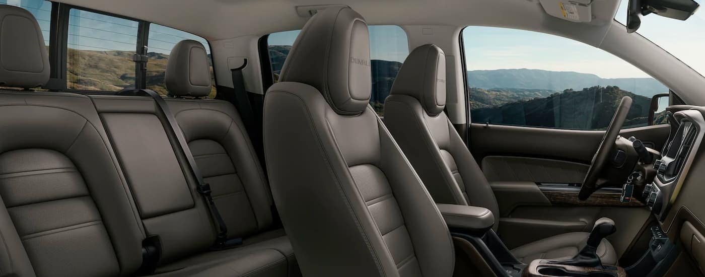 The black interior is shown from the passenger side in a 2021 GMC Canyon Denali.