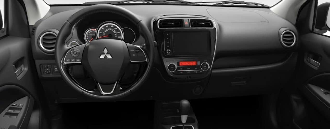 The black interior and dashboard are shown in a 2021 Mitsubishi Mirage.
