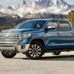 A blue 2020 Toyota Tundra is parked in the mountains.