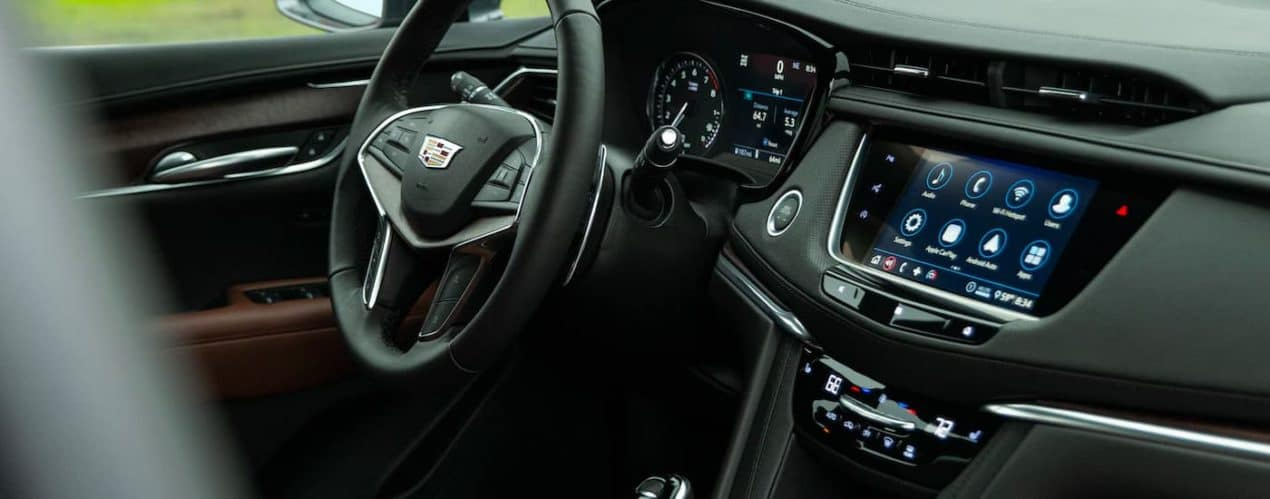The black interior and dash are shown in a 2022 Cadillac XT5.