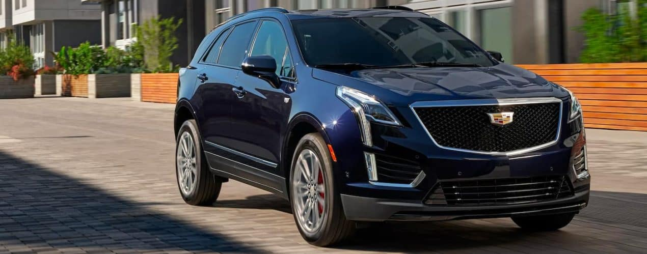 A black 2022 Cadillac XT5 is shown parked in a lot.