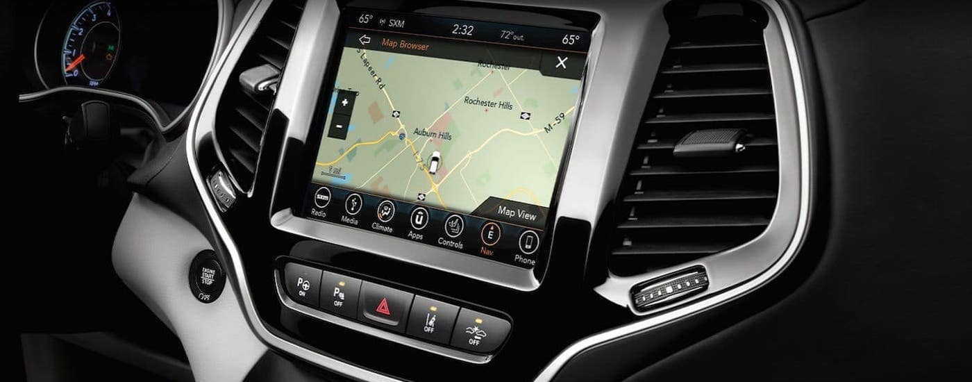 A closeup shows the infotainment screen in a 2020 Jeep Cherokee.